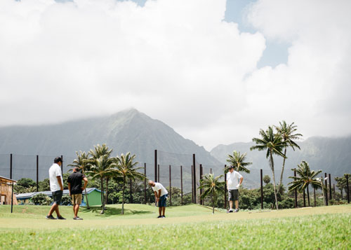 A group of men golf at Bay View Golf Course in Kaneohe
